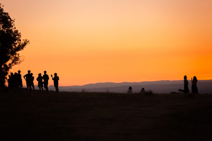 event photography People watching the sunset over the mountains of the victorian high country at Beechworth Music Festival